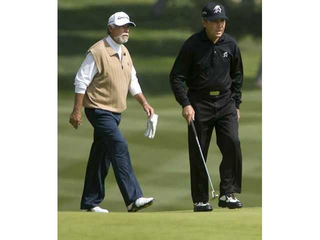Rich Contreras, left, and Gary Player, right, make their way to the 18th hole Sunday at the Valencia Country Club.