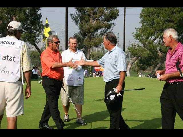 Fuzzy Zoeller, Mark O'Meara and John Jacobs are pictured on the 18th hole at Valencia Country Club, at the end of 54 holes over three days in the 2007 AT&T Champions Classic.