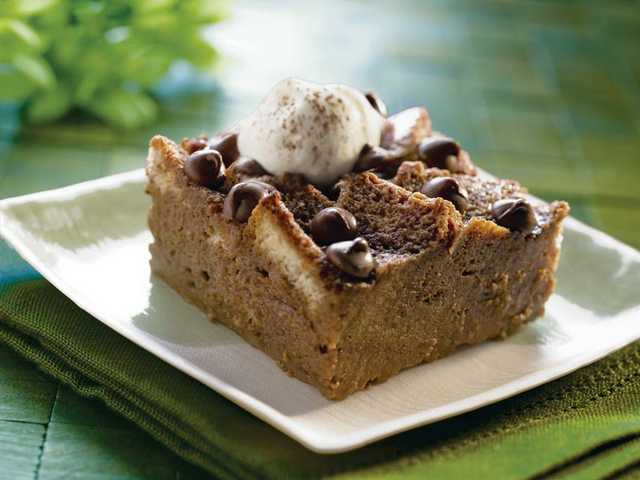 Chocolate Shamrock Bread Pudding    Servings: 1210 slices bread, cubed (6 cups)2 cans (12 fluid ounces each) Nestlé Carnation Evaporated Lowfat 2% Milk2 cups (12-ounce package) Nestlé Toll House Semi-Sweet Chocolate Morsels, divided8 large egg yolks, beaten3/4 cup granulated sugar1/2 cup Irish cream liqueur (optional)1/4 teaspoon saltWhipped cream (optional)Nestlé Toll House Baking Cocoa (optional)PREHEAT oven to 350º F. Grease 13 x 9-inch baking dish. Place bread cubes in prepared baking dish.HEAT evaporated milk in medium saucepan over MEDIUM-HIGH heat; bring just to a boil. Remove from heat. Add 1 1/2 cups morsels; whisk until smooth.COMBINE egg yolks, sugar, liqueur and salt in large bowl. Slowly add milk mixture; whisk until smooth.  Pour over bread; pressing bread into milk mixture.BAKE for 35 to 40 minutes or until knife inserted in center comes out clean. Top with remaining 1/2 cup morsels. Serve warm with a dollop of whipped cream and dusting of cocoa, if desired.TIP: This recipe can also be made with Nestle Carnation Evaporated Fat-Free Milk. Nutrition information per serving: 420 calories; 140 calories from fat; 15g total fat; 9g saturated fat; 145mg cholesterol; 270mg sodium; 59g carbohydrate; 3g fiber; 46g sugars; 10g protein; 20% Calcium