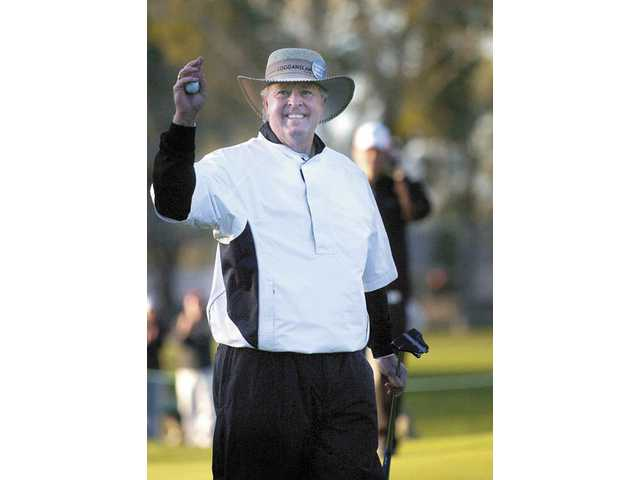 Denis Watson waves to cheering spectators on the 10th green after sinking the playoff putt worth $240,000 as winner of the 2008 AT&T Champions Classic tournament at Valencia Country Club.