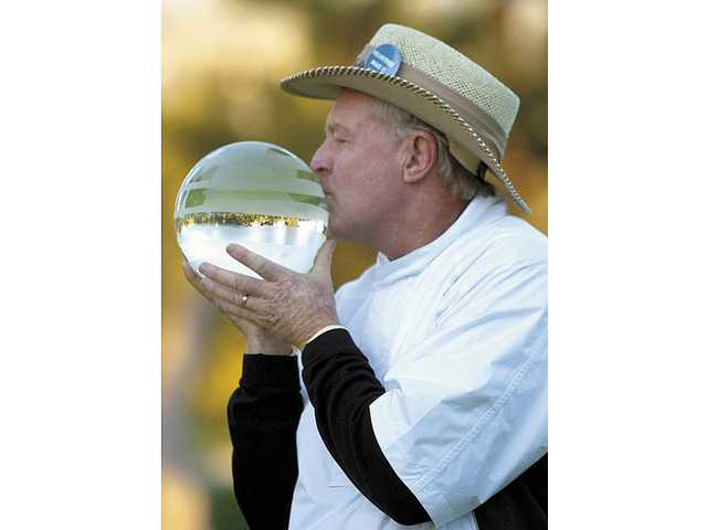 How sweet it is: Denis Watson tastes the victory Sunday afternoon at the Valencia Country Club, where he won the 2008 AT&T Champions Classic golf tournament.