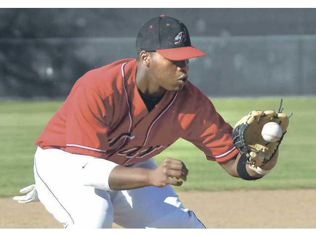 Hart third baseman Adam Bouyer fields a West Torrance grounder Tuesday at Hart High School.