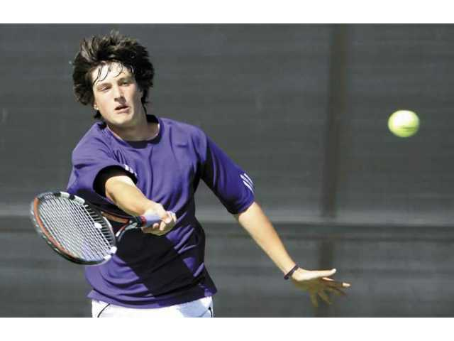 Valencia's Jack Zapala returns a shot during his match against West Ranch's Beau Martin Tuesday afternoon at West Ranch High School. Zapala beat Martin 6-0 in the match and Valencia won 11-7 overall.