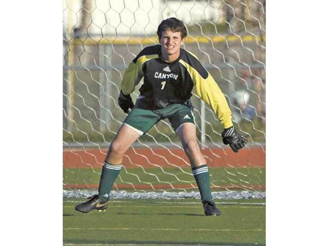 Canyon goalkeeper Andrew Wilson minds the net this past season. Wilson was named Foothill League Player of the Year by the coaches.