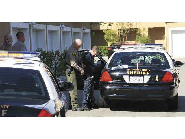 Santa Clarita Valley Sheriff's deputies arrest Aaron Kellingsworth, of Lancaster, following a high-speed chase along McBean Parkway on Tuesday afternoon.