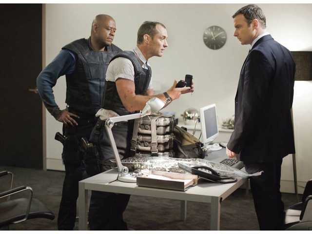 "From left, Forest Whitaker, Jude Law and Liev Schreiber are shown in a scene from Universal's ""Repo Men."""