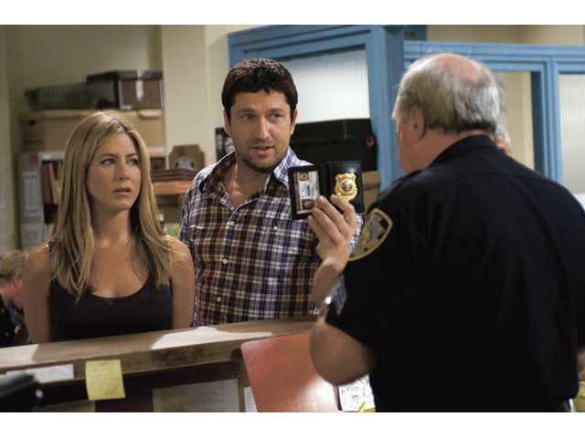 "Jennifer Aniston, left, and Gerard Butler are shown in a scene from the action comedy ""The Bounty Hunter."""