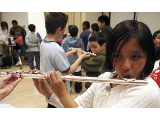 Lili Alevar tries her hand at the flute.
