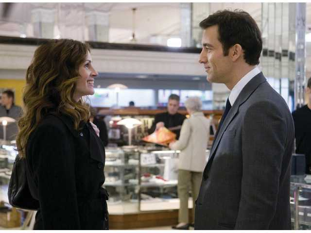 "Julia Roberts and Clive Owen are shown in a scene from ""Duplicity."""