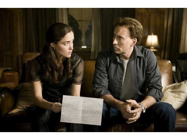 "Nicolas Cage, right, plays a professor of astrophysics and Rose Byrne, discuss the mysterious numbers that seem to predict the future in the sci-fi thriller ""Knowing."""