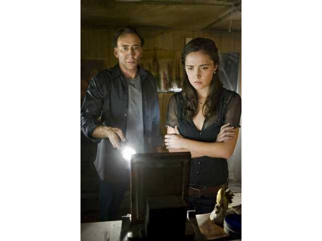 "Nicolas Cage, left, and Rose Byrne in ""Knowing."""
