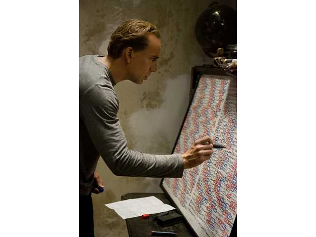 """Nicolas Cage is shown working out the math in a scene from """"Knowing,"""" which opens in theaters today."""