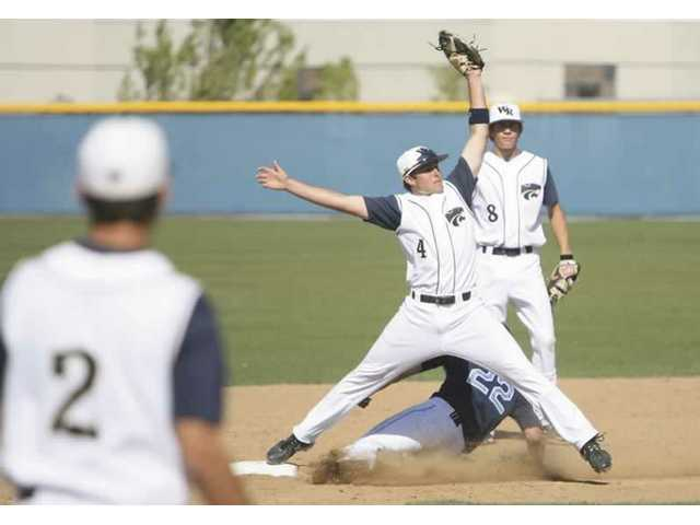 West Ranch's Cal Vogelsang stretches to force out Saugus' Aaron Hooper at second base in the second inning of the Centurions 12-3 win over the Wildcats Wednesday at West Ranch High.