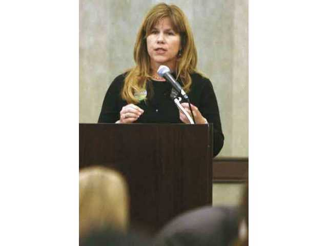 Laurie Ender, top vote-getter in the race for two seats on the Santa Clarita City Council Tuesday, speaks at the Valley Industrial Association's monthly luncheon in March.