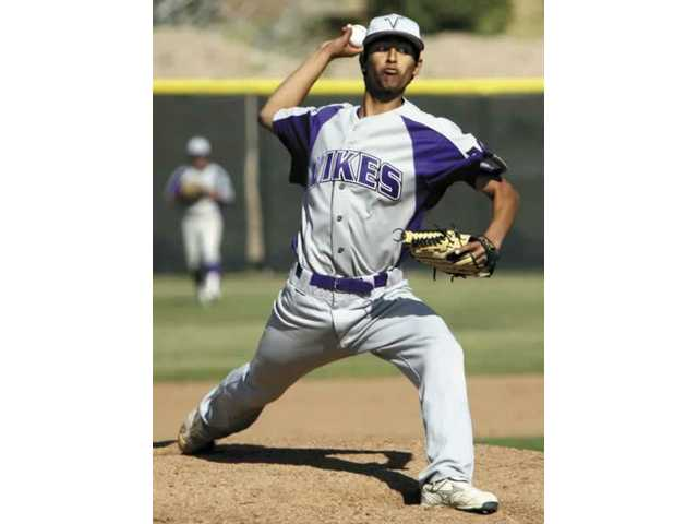 Valencia starting pitcher Josh Corrales delivers a pitch in the second inning during the Vikings game Wednesday afternoon at Canyon High.