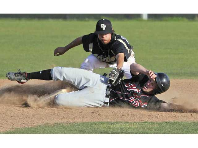 Golden Valley second baseman Billy Fredrick attempts to tag out Hart's Kevin Bailey on Friday at Golden Valley High.