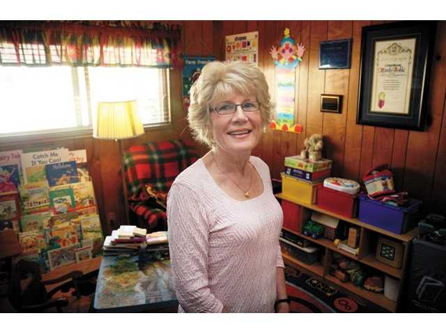 Hjordis Bakke in the kid's playroom of her Saugus home. Bakke was one of the original childcare providers in the SCV, and she is still working.