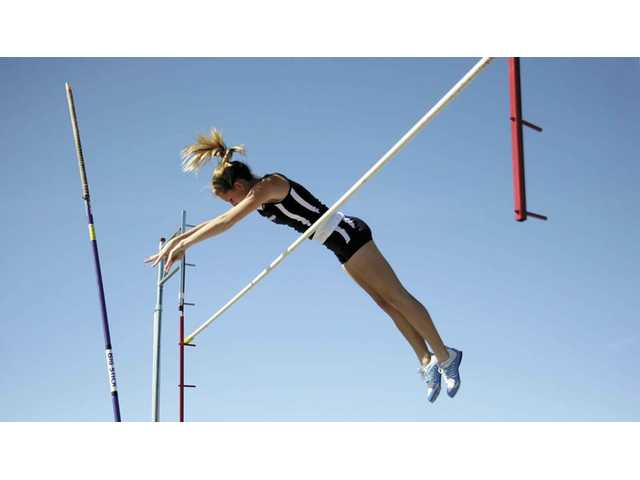 Saugus pole vaulter Jamie Tripp clears the bar on Thursday at Saugus High in a duel meet against Valencia. She took third in the event.
