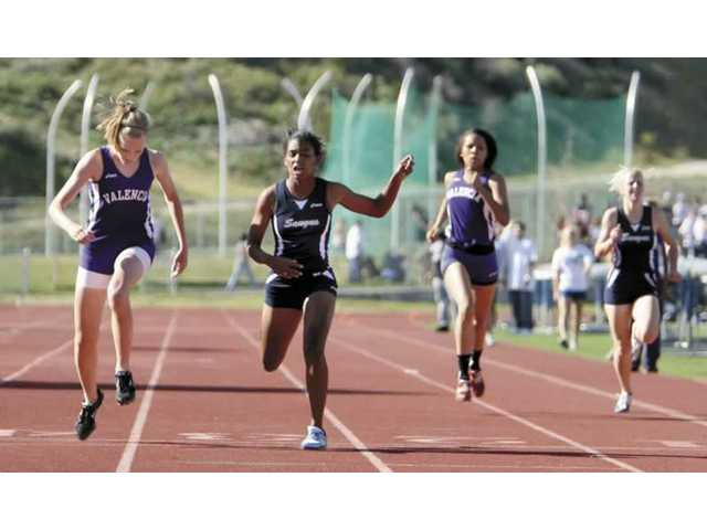 Saugus and Valencia girls varsity 400 meter runners finish up their race on Thursday at Saugus High. The Centurions won both boys and girls varsity events.