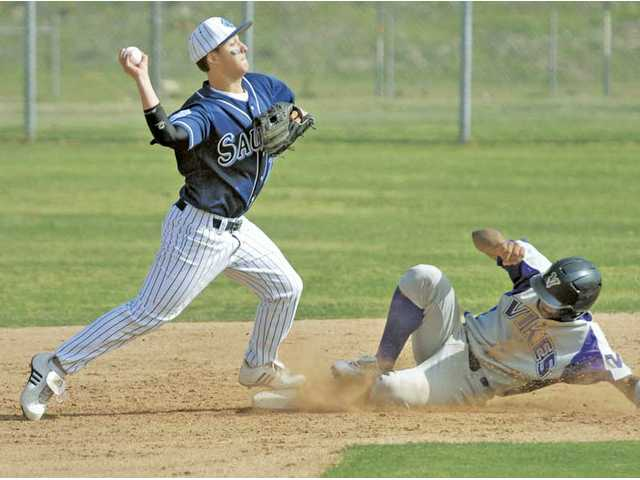 Saugus second baseman Brett Piper, left, makes the tag and turns to throw to first as Valencia baserunner Trey Williams slides into second Friday at Saugus.