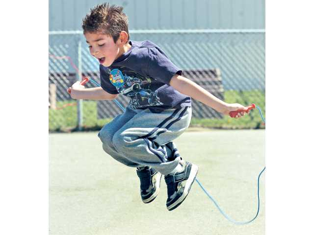 Daniel Villegas gets airborne as he jumps rope as part of the school's activity.