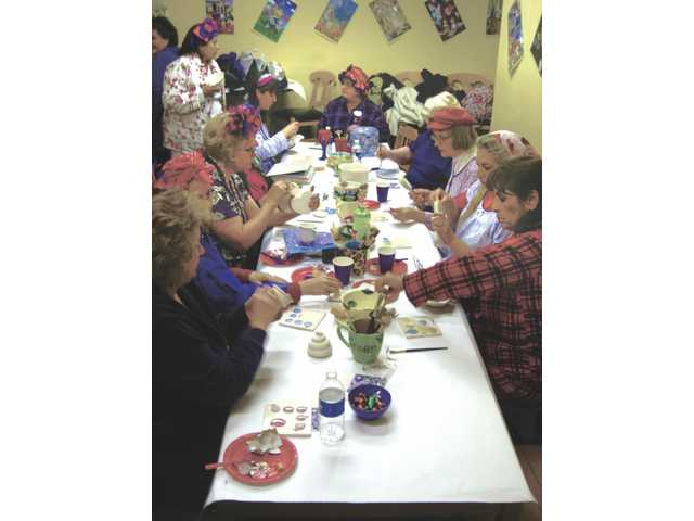 Red Hat Cuties: Seniors paint ceramics and celebrate life