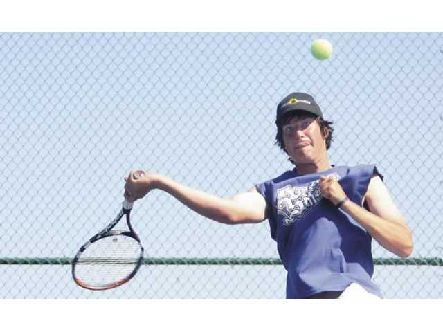 Valencia's Jack Zapala hits a forehand shot against temmate Tyler Gottshall in the championship match of the Spring Smash tournament held at Valencia High on Satuday. Zapala went on to defeat Gottshall 8-3 to win the tournament.