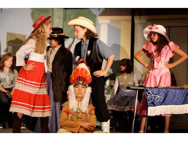 From left to right, Skylar Heinsberg, Jill Young, Alexis Romero, Kate Wisdom, Dennis Atlas, Maya Miranda and Sammy Gebers perform a scene from 'Annie Get Your Gun.'