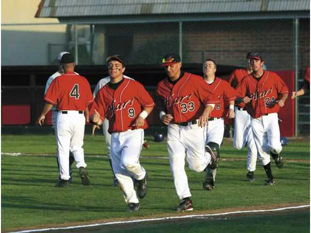 Members of the Hart High baseball team jog off the field after a game Feb. 29. The Indians are 8-3 this season and 3-0 in the Foothill League after defeating Saugus High on Friday.