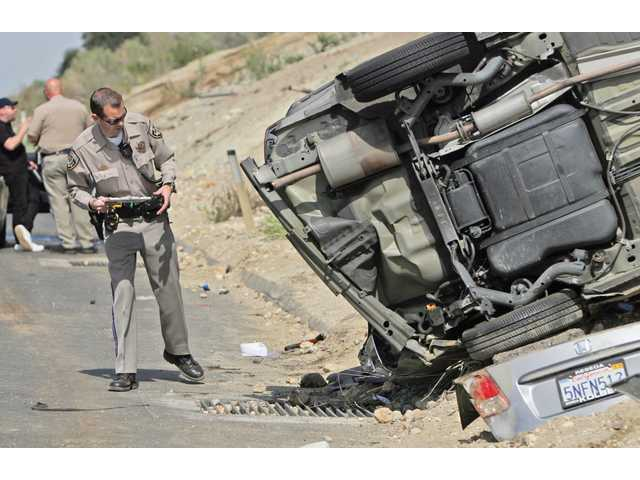 Two vehicles collided at 2:14 p.m. Wednesday on the side of Highway 14 Freeway northbound about one-half mile north of Placerita Canyon Road, causing one to overturn on its side, authorities said.