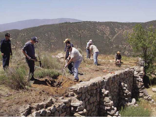Volunteers work to repair the site of the Tumble Inn, which was one of several hotels that were once in operation along the Ridge Route. The route opened in 1915 and was paved four years later.