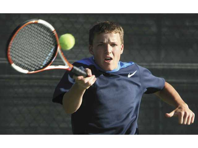 West Ranch No. 3 singles player Beau Martin returns the ball during his set against Canyon's No. 1 player Jason Ferlianto on Tuesday. Martin won the set 6-2.