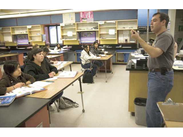 Castaic Middle School teacher Matthew Rubin teaches a science class in February.