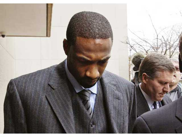 This Jan. 15, 2010, file photo shows Washington Wizards' Gilbert Arenas arriving at D.C. Superior Court in Washington, D.C., to answer a felony charge of carrying a pistol without a license. Arenas says he deserves to be punished for bringing guns to the locker room.