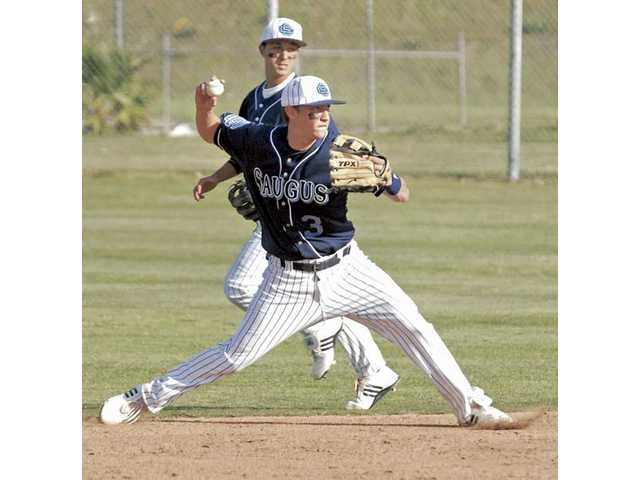 Zachary Vincej (3) of Saugus, backed up by Brett Piper throws to first base for the out against West Ranch on Wednesday.