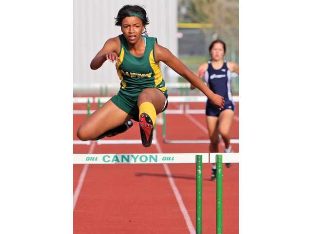 Canyon High's Taylor Thompson leads the 300-meter hurdles against Saugus at Canyon on Thursday.