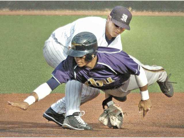 The Master's College second baseman Bryan Mitchell, back, makes the tag on California Baptist base runner Matt Johnson in the eighth inning Thursday at Reese Field. TMC lost 11-4.