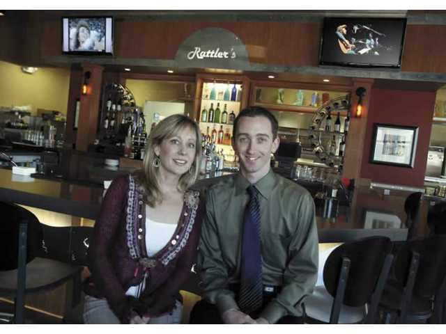 Rattlers' co-owner Mary Harrigan and general manager, Travis Histings, sit inside the restaurant's bar in their new location in Centre Pointe Marketplace.