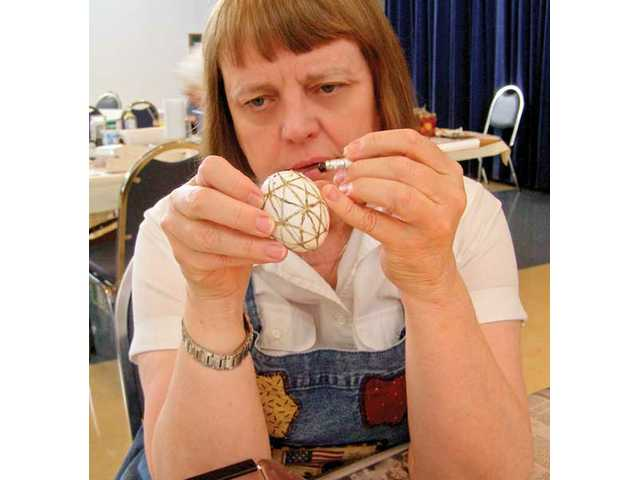 Phoebe McPhadden works on decorating a golden Pysanky egg on Sunday at St. Stephen's Episopal Church's fourth annual Pysanky egg-making class.