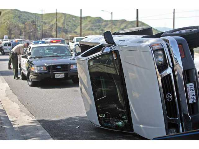 Santa Clarita Valley Sheriff's Station deputies said this overturned Toyota pickup was involved in a collision with a Toyota Corolla on Friday on Soledad Canyon Road.