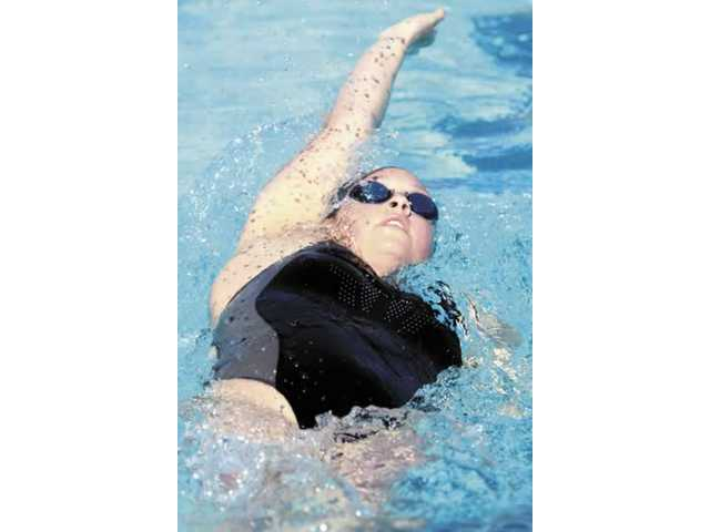 Hart High School's Jordan Danny swims the backstroke segment of the varsity 200-yard individual medley versus West Ranch on Wednesday. Hart's girls varsity team defeated West Ranch 133-37.