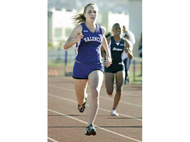 Valencia's Aly Drake, front, runs the 400-meter race Thursday at Valencia High School. Drake broke her own school record in the 800.