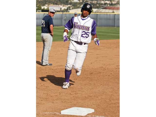 Valencia High shortstop Trey Williams rounds third base after hitting a grand slam in the fourth inning during Valencia's 8-4 victory over West Ranch at Valencia High. Williams tallied six RBIs in the game.