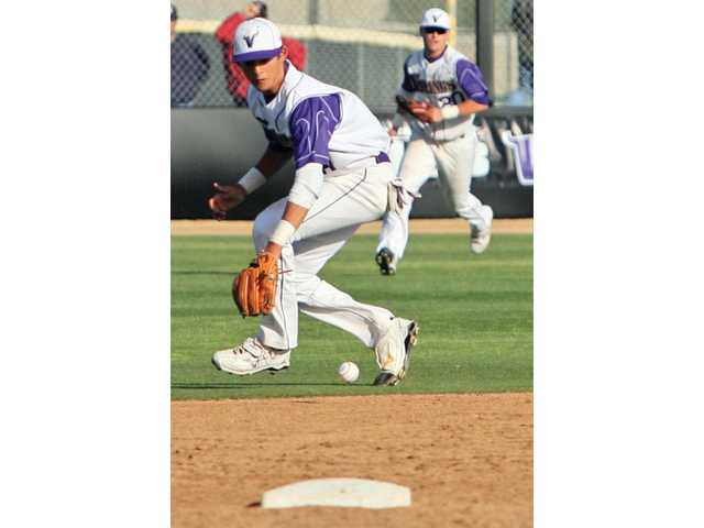 Valencia second baseman Quincy Quintero fields a ground ball Friday at Valencia High in the Vikings' 8-4 win.