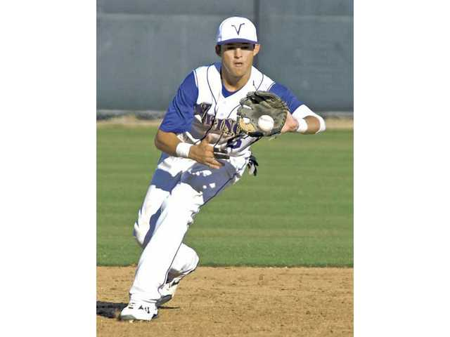 Quincy Quintero fields a ground ball in the sixth inning of Valencia's 11-4 win over Golden Valley at Valencia High.