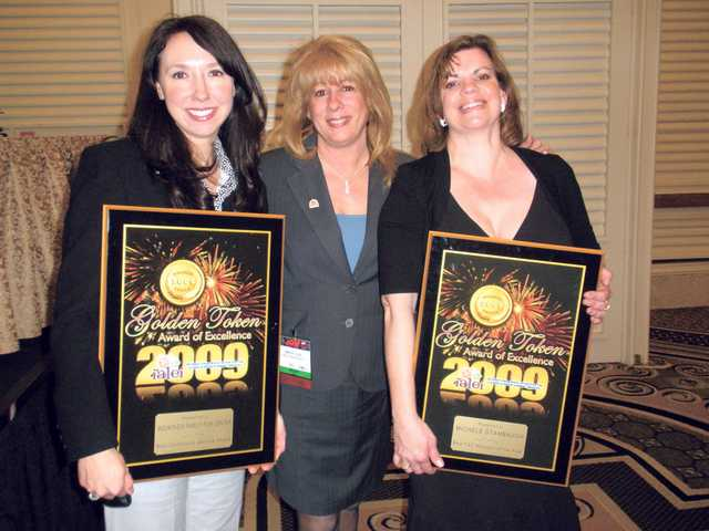 Mountasia Family Fun Center's marketing director Courtney Bourdas-Henn, left, and General Manager Michele Stambaugh, right, pose with their awards received at the International Association of the Leisure and Entertainment Industry convention held last week at the Las Vegas Convention Center.