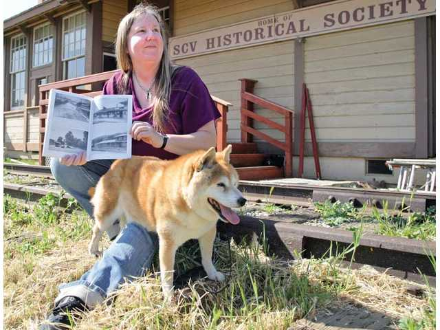Maggi Perkins, with her dog Kitsune, recently published a book on the history of Newhall. Perkins is the granddaughter of the SCV's first historian, A.B. Perkins.