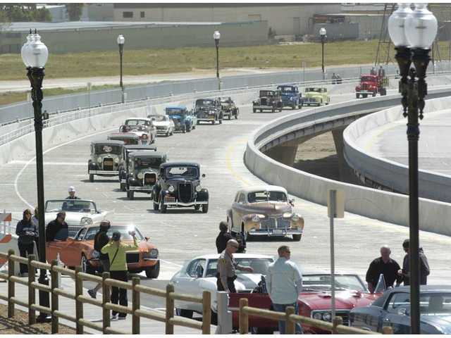 A group of classic cars make the return trip on the northbound side of the cross-valley connector.