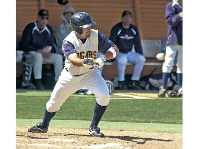 College of the Canyons' Cal Vogelsang (3) lays down a bunt single in the third inning against Glendale College at COC on Saturday. COC shut out Glendale, 7-0.