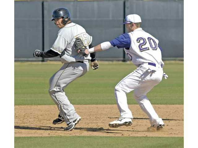 Valencia's Kyle Eaton (20) tags Golden Valley's Philip Anderson Friday at Valencia High. The Vikings defeated Golden Valley 11-4.